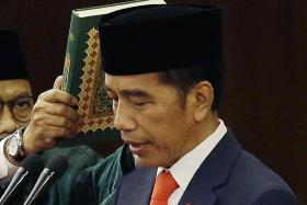 Indonesia's Joko sworn in, vows to cut red tape