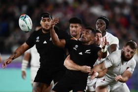 New Zealand's wing Sevu Reece (centre) trying to break through the England defence.