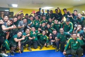 Kedah's players and staff celebrating after booking their place in the Malaysia Cup final.