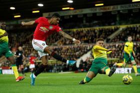 Marcus Rashford attempting a shot against Norwich City.