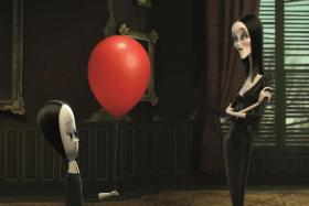 Chloe Grace Moretz (left) voices Wednesday and Charlize Theron voices Morticia in The Addams Family