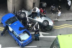 Taxi, car crash into AIA Tower after a collision