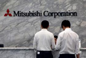 Mitsubishi also said it would cut its full-year earnings forecast because of the Petro-Diamond losses and lower coal prices.