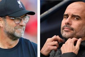 Liverpool manager Juergen Klopp (left) has called Manchester City boss Pep Guardiola the best manager in the world.