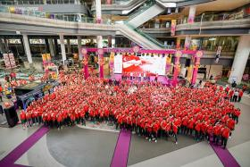 Singapore athletes heading to the SEA Games, Asean Para Games and Winter Youth Olympics taking a group photo at the official flag presentation ceremony at Our Tampines Hub on Saturday (Nov 9).