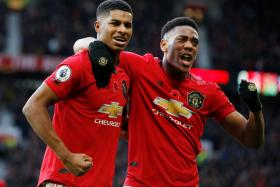 Manchester United's Marcus Rashford and Anthony Martial celebrating their third goal.