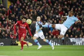 Mohamed Salah scoring Liverpool's second goal.