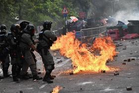 HK university campuses turn into battlegrounds