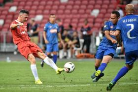 Liverpool Reds' Luis Garcia attempting a shot against the Singapore Reds.