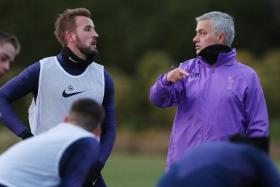 Jose Mourinho (right) having a word with Harry Kane during his first training session as Tottenham Hotspur manager.