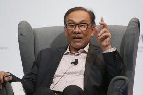 Anwar, Mahathir meet to discuss transition