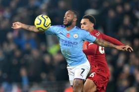 Manchester City's Raheem Sterling surging ahead of Liverpool's Trent Alexander-Arnold during City's 3-1 defeat earlier this month.