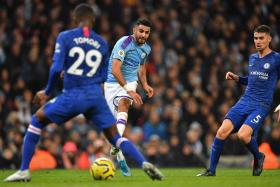 Riyad Mahrez scoring Manchester City's second goal.