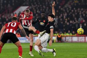 Sheffield United's Oliver McBurnie making it 3-3 in stoppage time.