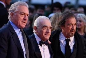 """(From left) US actor Al Pacino, US filmmaker Martin Scorsese and US actor Robert De Niro pose on the red carpet as they arrive to attend the international premiere of the film """"The Irishman"""" during the closing night gala of the 2019 BFI London Film Festival in London on October 13, 2019."""