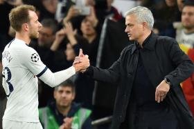 Jose Mourinho celebrates with Christian Eriksen after Spurs' victory.