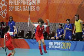 Singapore's Siti Nurhaliza Khairul Anuar jumping for joy after scoring a goal against Thailand.
