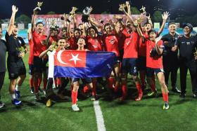 Johor Darul Ta'zim celebrating after winning the U-15 International Champions Cup, an invitational tournament organised by the Football Association of Singapore.