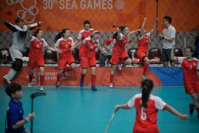 The Singapore women's floorball team celebrating their victory against Thailand.