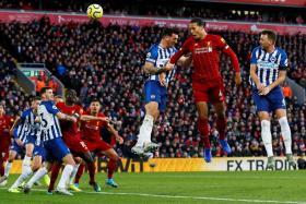 Virgil van Dijk scoring his and Liverpool's second goal with a header.