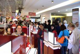 The queue at the Metro Paragon store.