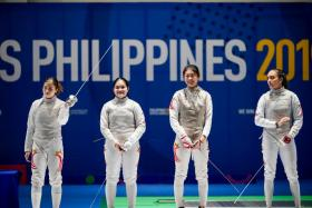 (From left) The Singapore women's foil team of Tatiana Wong, Maxine Wong, Denyse Chan and Amita Berthier.