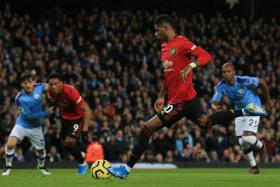 Marcus Rashford putting Manchester United ahead at the Etihad.