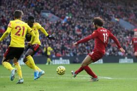 Mohamed Salah scoring Liverpool's first goal.