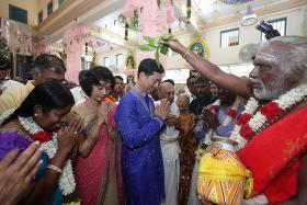 15,000 brave rain for temple's consecration ceremony