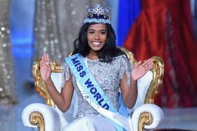 Newly crowned Miss World 2019 Miss Jamaica Toni-Ann Singh smiles during the the Miss World Final 2019 at the Excel arena in east London on December 14, 2019.