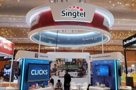 Grab, Singtel team up for digital full bank licence