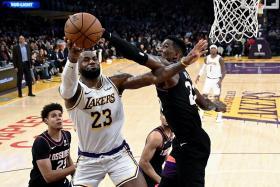 LeBron James' triple-double helps sink Phoenix Suns