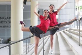Twin gymnasts master balancing act