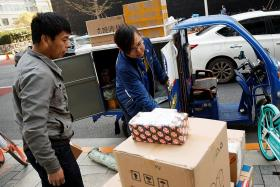 China's services growth slows in December
