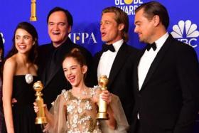 "(From left) Margaret Qualley, Quentin Tarantino, Julia Butters, Brad Pitt and Leonardo DiCaprio pose in the press room after winning the award for Best Screenplay - Motion Picture and Best Motion Picture - Musical or Comedy for ""Once Upon a Time...in Hollywood"" during the 77th annual Golden Globe Awards on January 5, 2020, at The Beverly Hilton hotel in Beverly Hills, California."