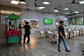 Competition heats up as GrabFood opens first shared kitchen here