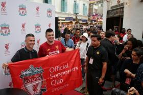Former Liverpool player Luis Garcia posing for photos during the official launch of the Liverpool FC Store at Bugis Junction on Friday (Jan 10).