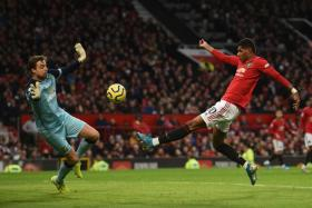 Marcus Rashford opening the scoring in Manchester United's 4-0 win over Norwich City.
