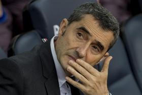 Ernesto Valverde clings on as Barcelona consider options