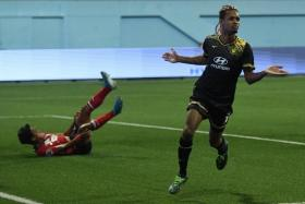 Tampines Rovers forward Jordan Webb wheels away after making it 2-2.