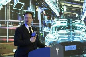 Musk close to earning first $466m tranche of options in record package