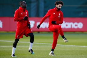 Liverpool's African players Sadio Mane (left), Mohamed Salah (right) and Naby Keita (not in picture) will miss up to a month in January 2021 if they play in the African Nations Cup.