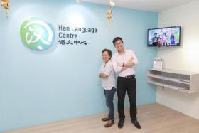 Han Culture & Education Group's CEO Lim Wei Yang (right) and principal Ooi Ching Ya