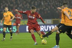 Roberto Firmino scoring Liverpool's winner in the 84th minute.