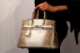 A Hermes signature Birkin handbag.