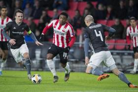 Steven Bergwijn (centre) playing for PSV Eindhoven in a Europa League match in December 2019.