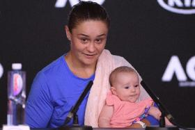 World No. 1 Ashleigh Barty, with her niece Olivia, at her post-match press conference after losing the women's singles Australian Open semi-final against Sofia Kenin.