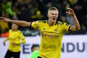 Erling Haaland celebrates after scoring against Union Berlin.