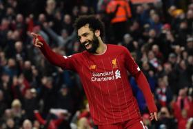Mohamed Salah celebrates after making it 4-0.