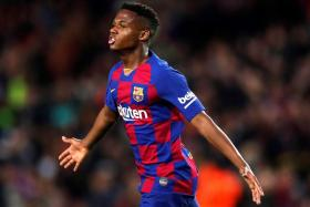 Teenage forward Ansu Fati became the youngest player to net a La Liga double, when the 17-year-old scored in Barcelona's 2-1 win over Levante.